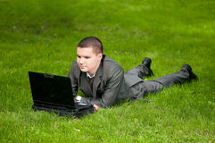 Business man work on notebook at park. Student Royalty Free Stock Images
