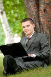 Business man work on notebook at park. Student Stock Images