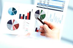 Business man working and analyzing financial figures on a graphs. Royalty Free Stock Photography