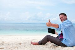 Business man working on the beach with pc Stock Photo