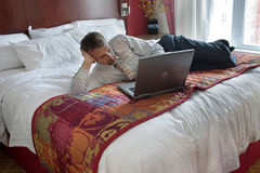 Business man working on bed Stock Image