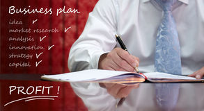 Business man working at business plan.  royalty free stock image