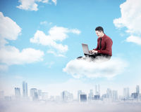 Business man working on the cloud above the city Stock Images