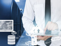 Business man working in data center with tablet device Stock Photo