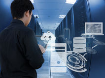 Business man working in data center with tablet device Stock Photography