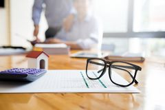 Business man working desk with financial paperwork data loan agr. Business man working desk with financial paperwork data about loan agreement with financial Royalty Free Stock Photography