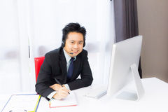 Business man working with desktop computer Stock Photos