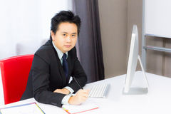 Business man working with desktop computer Stock Images