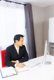 Business man working with desktop computer Stock Image