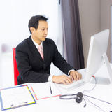 Business man working with desktop computer Royalty Free Stock Photography