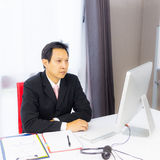 Business man working with desktop computer Royalty Free Stock Photo