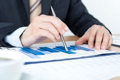 Business man working with diagrams Stock Image