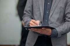 Business man working with a digital tablet Stock Image