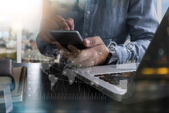 Business man working on digital tablet computer and smart phone Royalty Free Stock Image