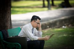 Business man working on digital tablet feel stressed/worry/heada. Che/disappoint during working Royalty Free Stock Photo