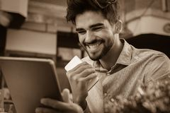 Business man working on digital tablet in street cafe. stock image