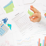 Business man working with financial data - OK sign - studio shot Stock Photo