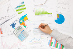 Business man working with financial data - pen in hand Royalty Free Stock Images