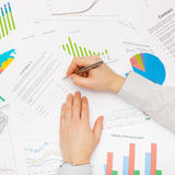 Business man working with financial data - preparing for signing contract - studio shot Stock Photos