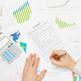 Business man working with financial data - signing contract - studio shot Stock Photography