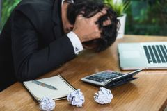 Business man working him fail frustrated. On laptop computer, focus paper royalty free stock photography