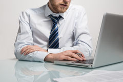 Business man working with his notebook Royalty Free Stock Photos