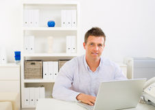 Business man working at home. Business man working on laptop computer at home stock image