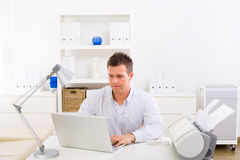 Business man working at home. Business man working on laptop computer at home royalty free stock photography