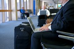 Business man working on lap to. P at the gate in airport terminal Stock Images