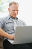 Business man working on a laptop Royalty Free Stock Photo