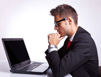 Business man working on laptop computer Stock Images