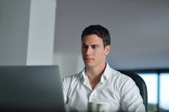 Business man working on laptop computer at home Stock Photos