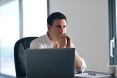 Business man working on laptop computer at home Stock Images