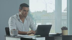 Business man working at laptop computer. Concentrated man preparing documents. Business man working at laptop computer in luxury house. Concentrated man stock video