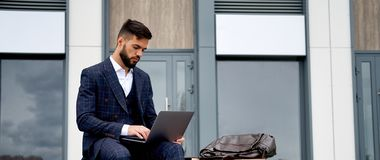 Business Man Working on Laptop Computer panoramic banner with copy space stock photos