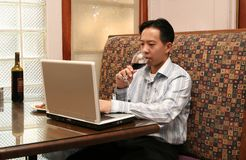 Business Man Working With Laptop And Drink Wine 2 Royalty Free Stock Images