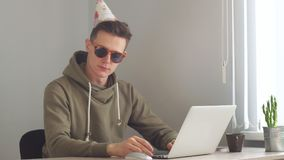 Business man working on a laptop on his birthday stock video