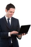 Business man working on laptop isolated on white Stock Images