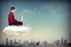 Business man working with laptop on the sky Royalty Free Stock Photos