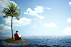 Business man working with laptop on the small island Stock Images