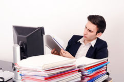 Business man working with a lot of paper work. Stock Photography