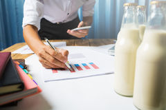 Business man working at milk bottle quality control hard job con. Business man working in milk bottle quality control hard job concept, quantity checking in the Royalty Free Stock Photo