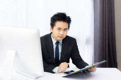 Business man working with notepad Royalty Free Stock Image