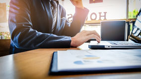 Business man working at office with laptop, tablet and graph dat Royalty Free Stock Images