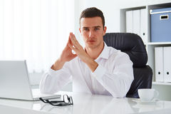 Business man working in an office with a laptop Stock Images