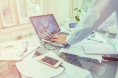 Business man working on open laptop at home office. Open laptop and accessories for home workplace, business and finance concept royalty free stock images