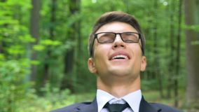 Business man working outdoors, non-allergic office environment, free breathing. Stock footage stock video