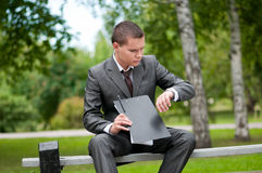 Business man working with papers at park. Student Stock Photography