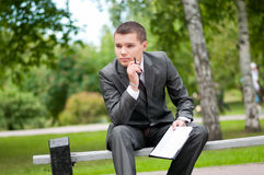 Business man working with papers at park. Student Royalty Free Stock Photos