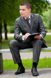 Business man working with papers at park. Student Stock Images